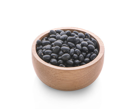Black beans in wooden spoon isolated on white background Foto de archivo - 122767674