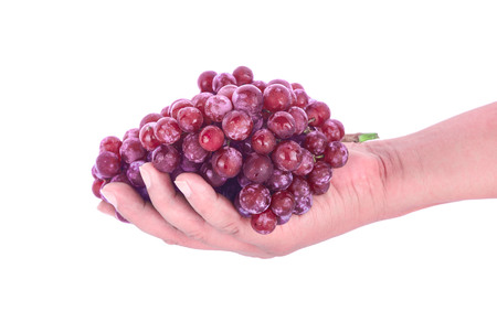 Red grapes on hand  isolated on white background. Banque d'images - 122767742