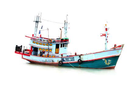 Small fishing boat isolated on white background Foto de archivo