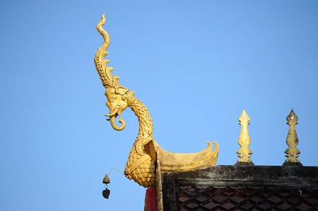 golden carve work on the roof of temple, thailand photo