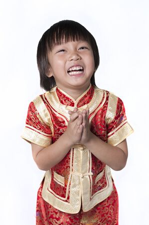 asian family fun: Happy Chinese new year.The boys congratulate with the Chinese New Year, isolated on white background.