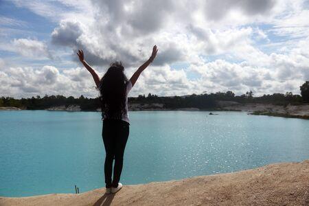 kaolin: A young women stand near Kaolin lake-, Belitung