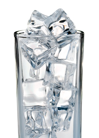 Cold ice cubes in the glass isolated on white background photo