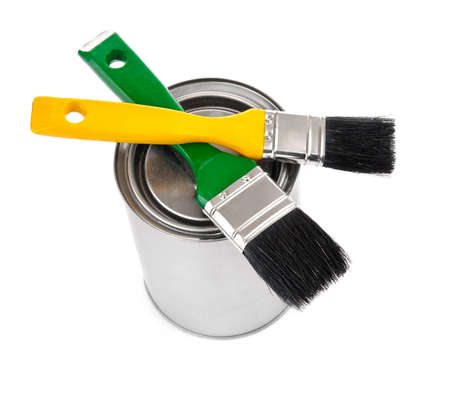 brushes and tin with paint for home maintenance isolated on white background Stock Photo