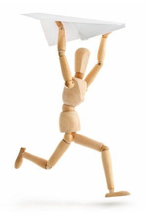 wooden man running with paper airplane isolated on white background Stock Photo