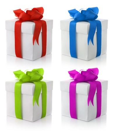 set of four gift boxes with color bows isolated on white background