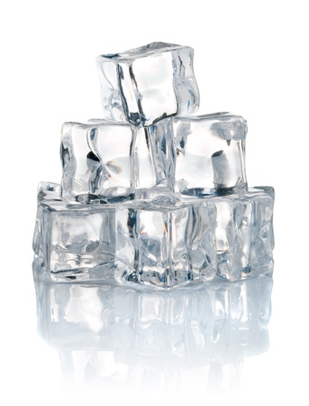 pile of cold ice cubes isolated on white background photo