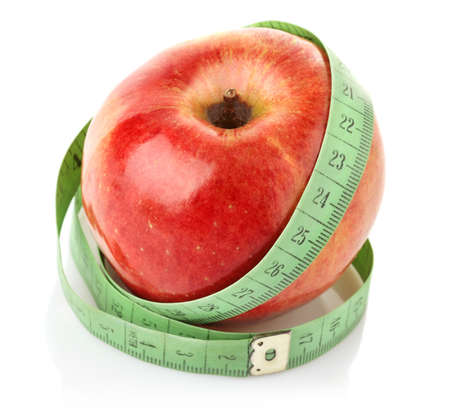 apple with measuring tape isolated on white background