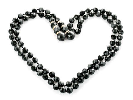 beads as heart isolated on white background