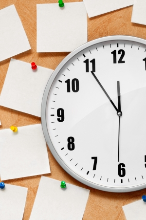 clock on wall with note Stock Photo