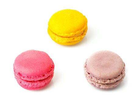 Three macaroons sweet desserts. Isolated on white background Stock Photo