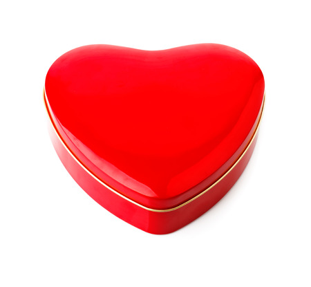 unexpectedness: Red gift box in form of heart. Isolated on white background Stock Photo
