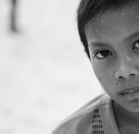 camra: Semporna, Maylaysia - Sep 29, 2013  A Bajau kid staring at camra, shot on Mabul island, Semporna, Sabah, Maylaysia  Bajau people are also referenced as the last sea gypsies,  sea-oriented, boat-dwelling, nomadic, and no country  Editorial