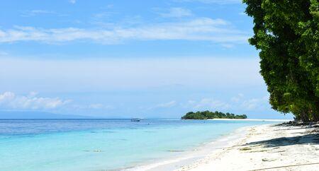 Beautiful scene of white beach and junle on Pulau Sibuan island,  Semporna, Sabah, Malaysia