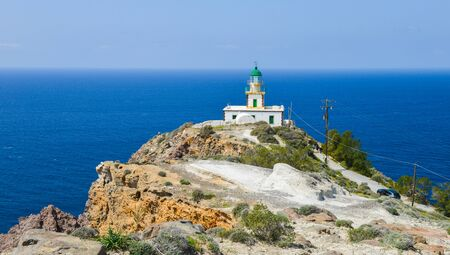 South lighthouse by the cliff on Santorini island, Greece