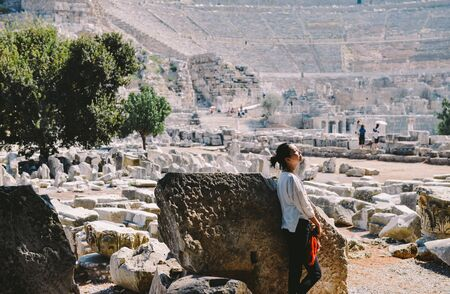 Single Asian woman enjoys the view at the great theate at Ephesus, Turkey