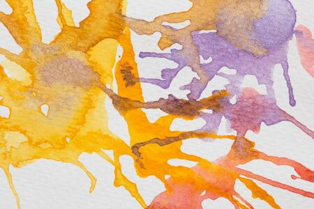 spalsh: abstract yellow,violet and red watercolor splash blot on paper