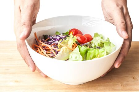 carot: mixed Salad bowl on wooden table close up top view