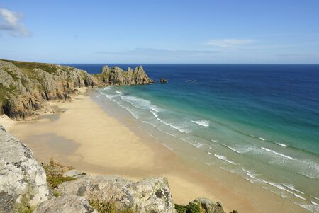 Pedn vounder beach, one of Cornwalls best beaches with stunning cliffs of Treryn Dinas, crystal clear water and a beautiful sandy beach.    On a spring low tide one can walk to Pedn Vounder from neighbouring Porthcurno beach but be warned, as the tide co Stock Photo