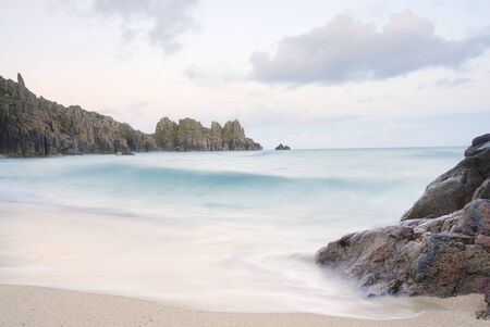 south west england: Pedn vounder beach, one of Cornwalls best beaches with stunning cliffs of Treryn Dinas, crystal clear water and a beautiful sandy beach.    On a spring low tide one can walk to Pedn Vounder from neighbouring Porthcurno beach but be warned, as the tide co Stock Photo