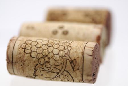 Simple studio shot of three wine corks. Focus on 1st cork, shallow DOF. Stock Photo - 10610535