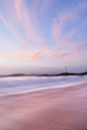 Slow shutter seascape. Northern Spain, view to lighthouse. photo
