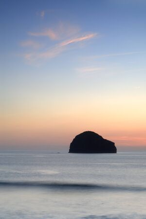 sea gull: Slow shutter seascape. View from Trebarwith beach to Gull Rock, UK.