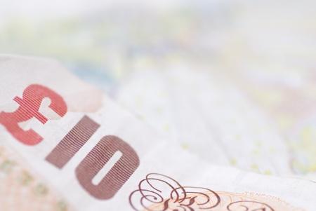 Macro image of English bank notes. Focus on £10.
