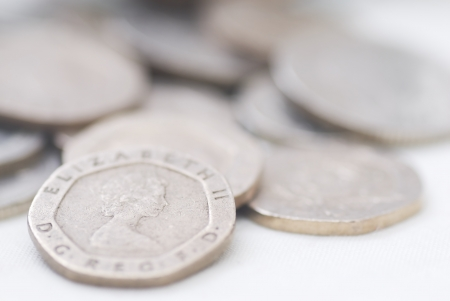 Spilled coins, focus on 20 pence coin. Sterling. Stock Photo