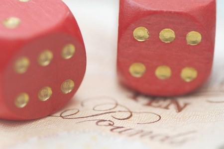 Two Dice on Bank Note, pound sterling. Stock Photo