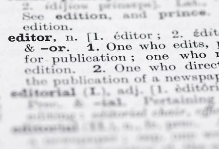 Shallow DOF, focus on Editor in English Dictionary. Stock Photo
