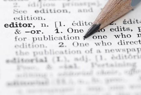 editor: Shallow DOF, focus on editor and nib of pencil. Stock Photo