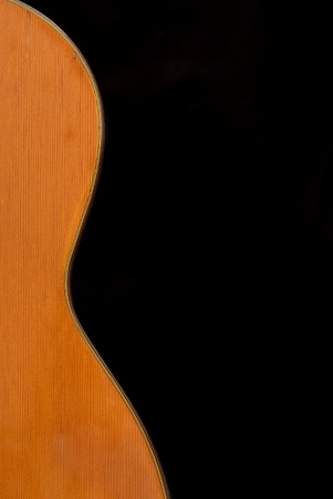 nylon string: Detail of classic guitar (Spanish), against black background.