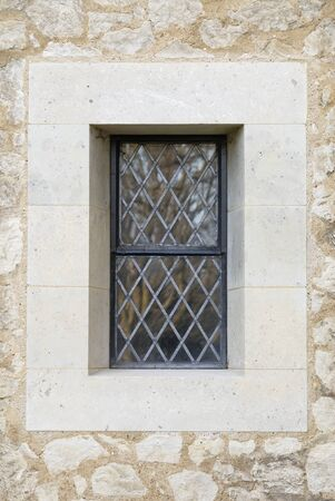 gothic window: Central leaded Church window surrounded by stonework.