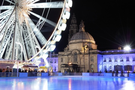 cardiff: An empty Ice rink and winterwonderland Cardiff. City Hall in background. Stock Photo