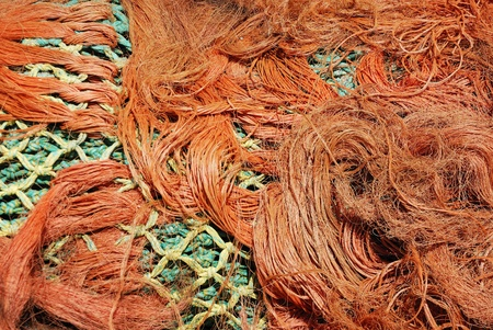 Multi-coloured fishing net in a tangle. photo
