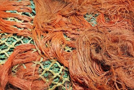 fishing net: Multi-coloured fishing net in a tangle.