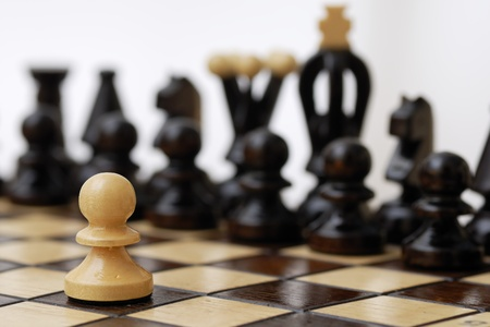 social issues: One pawn standing up to a stronger opponent.