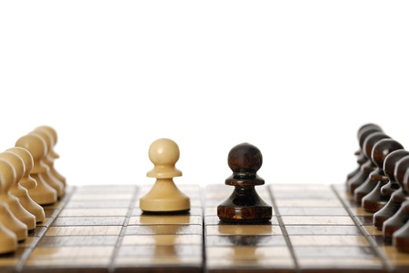 Two pawns in the centre of a chessboard.