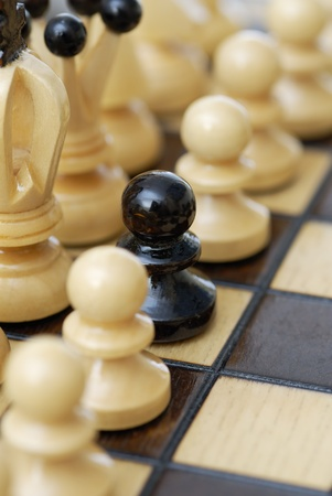 depiction: Depiction of a minority. Black pawn in white pawn line-up.