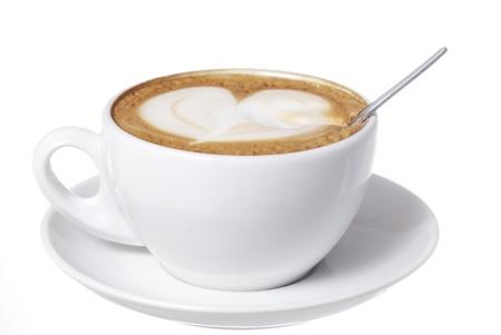 Latte art and spoon. Focus on Spoon.