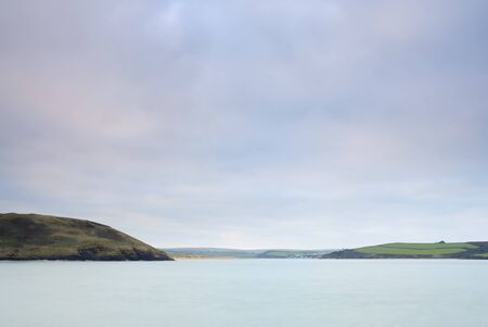 Cornish seascape shot in twilight. View up Camel estuary. Stock Photo