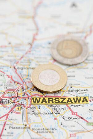 warszawa: Polish Zloty currency on map marked Warsaw (Warszawa) Stock Photo