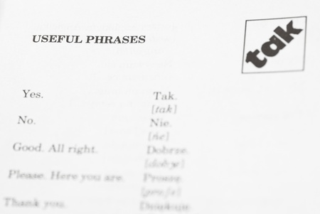 Macro image of first page of Polish phrase book. Stock Photo - 16565188