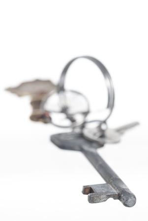Set of keys on keyring. White background. Stock Photo - 16565137