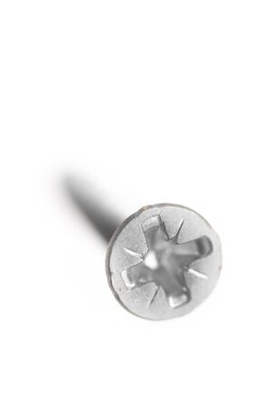 One new metal screw on white background. photo