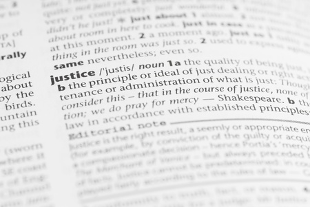 rightness: Macro image of dictionary word: Justice. Stock Photo