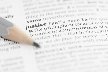 rightness: Macro image of dictionary word: Justice, and pencil. Stock Photo
