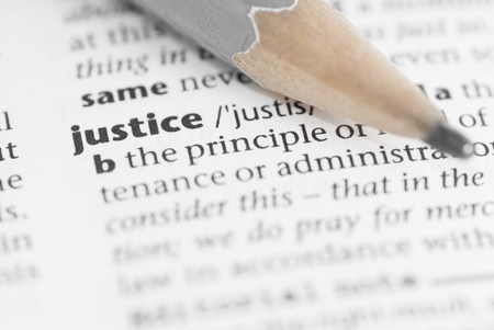 retribution: Macro image of dictionary word: Justice, and pencil. Stock Photo