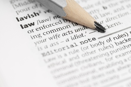 Macro image of dictionary word: Law, and pencil.